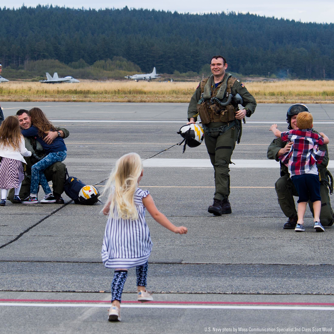 Pilots embrace their waiting family members for the first time following a seven-month deployment.