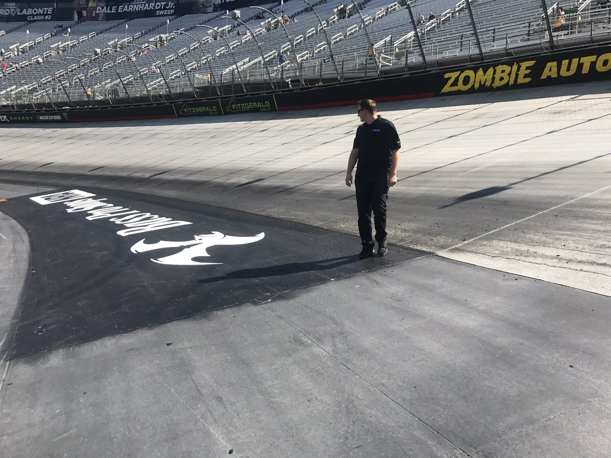 Doing some inspecting during the track walk earlier. #NASCAR