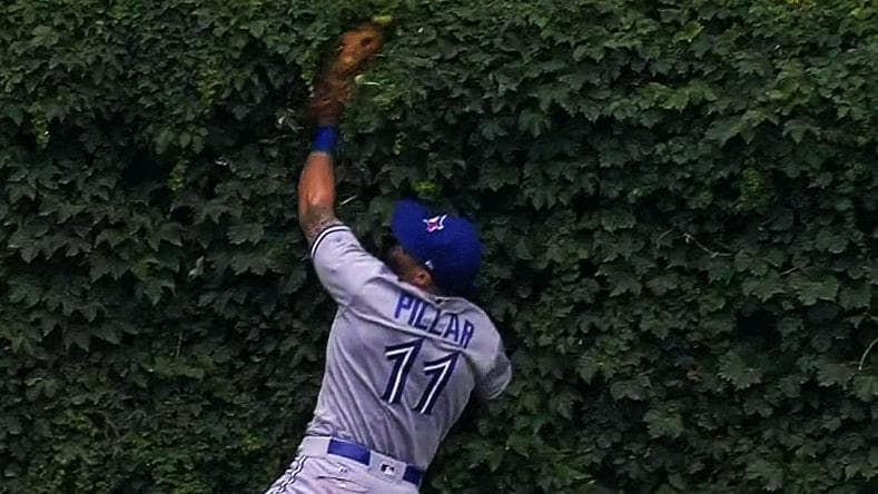 #GottaSeeIt: Kevin Pillar dives into the ivy at Wrigley to make a grea...