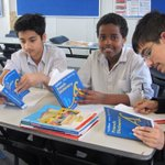 MFC Yr 7 French students Aarish, Yahye and Adib completing a reading and response activity using their new French bilingual dictionaries.
