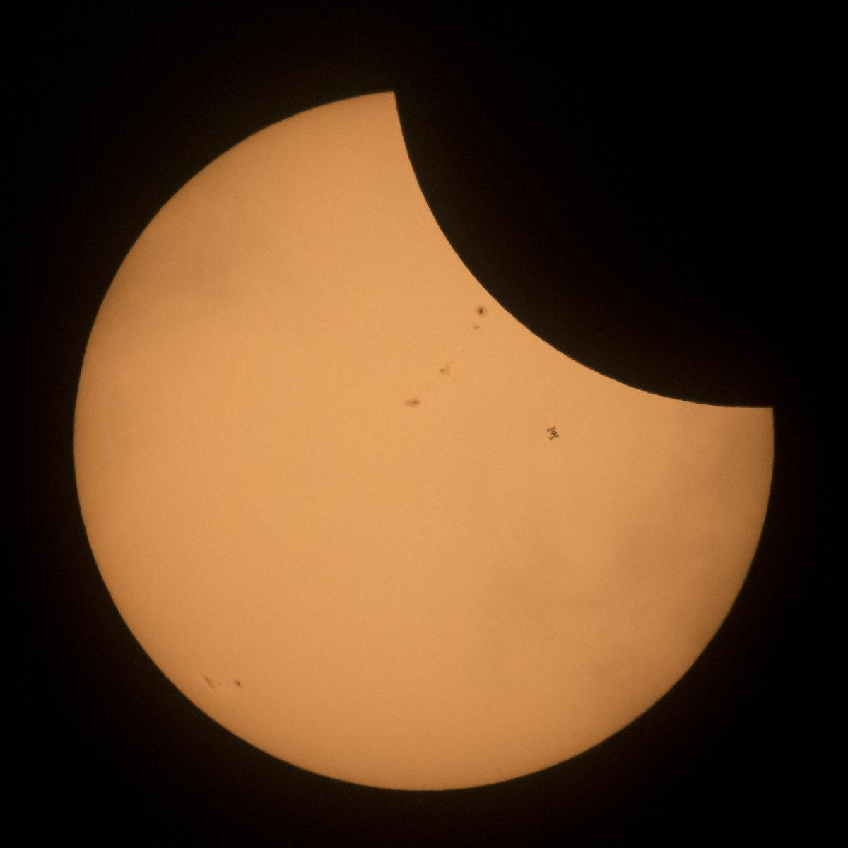 It's the moon, sunspots AND the station in front of the sun. @NASA photographer captures station transiting sun during #Eclipse2017