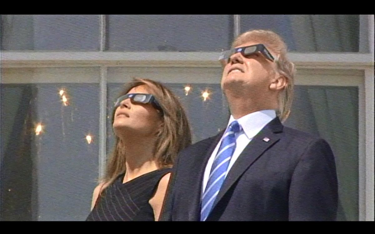Pres and Mrs Trump watch the eclipse.
