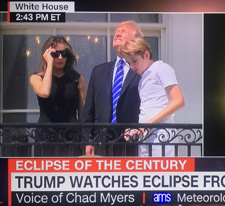 Aaaaaand here's your photo of Trump looking straight at the eclipse