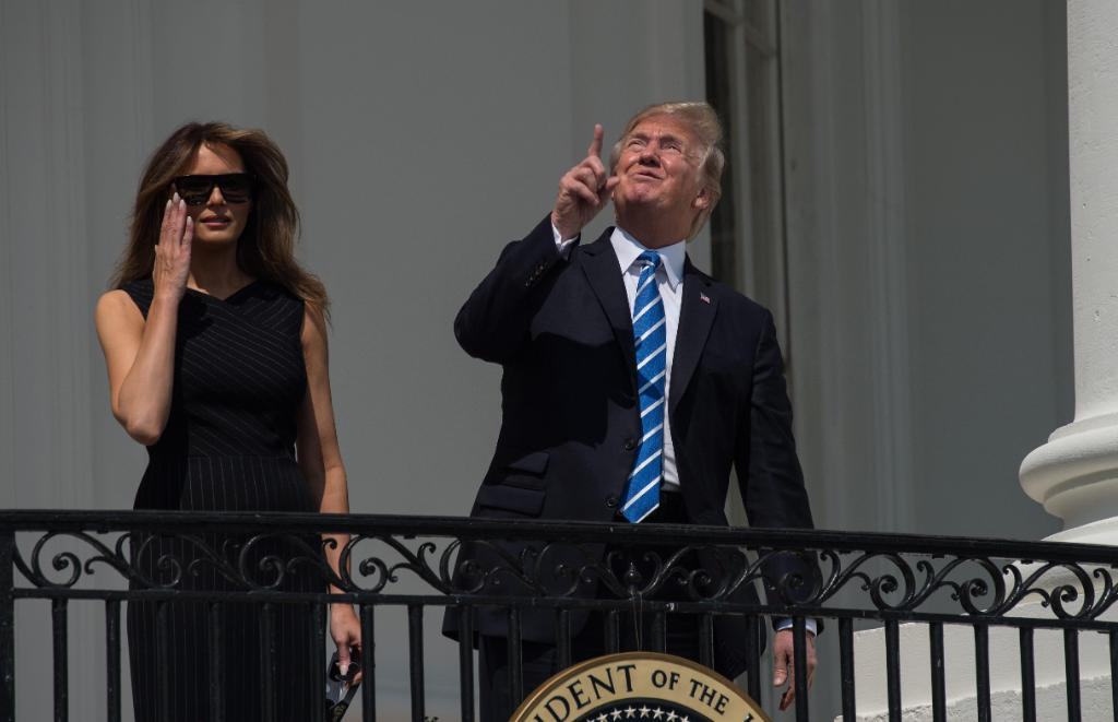 President Trump and First lady Melania Trump watch the eclipse from the Truman balcony of the White House