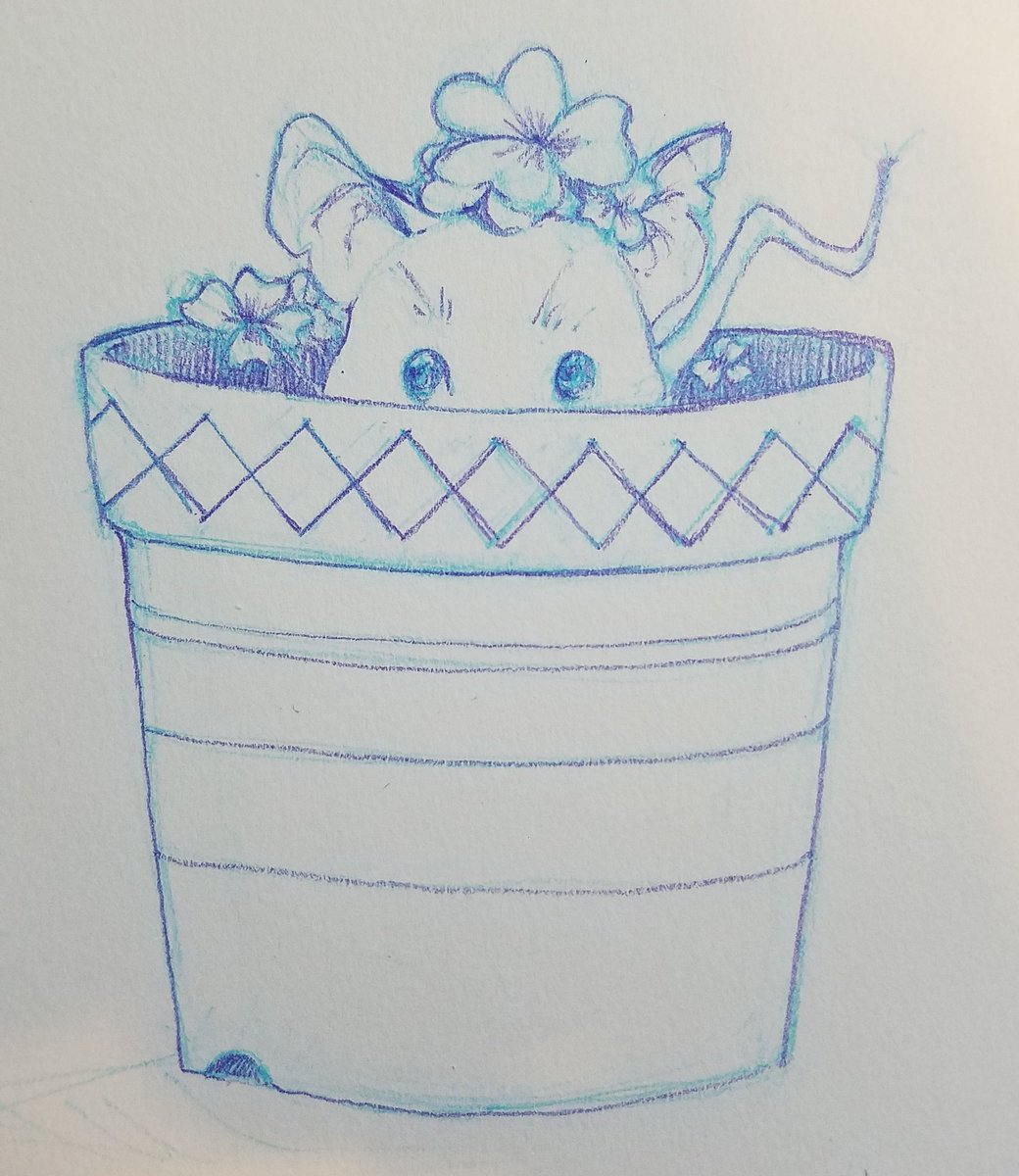 a mouse sitting in a flowerpot with sorrel