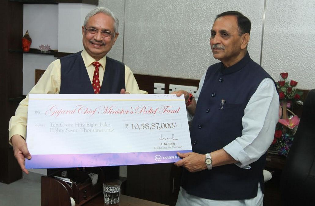 L&T present Rs.10 crore to CM Relief Fund, primary teachers Rs.9.67-lakh