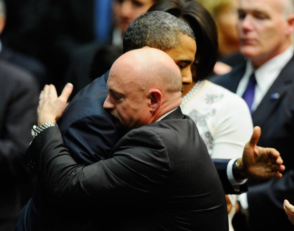 Barack Obama with Mark Kelly, husband of Gabby Giffords.