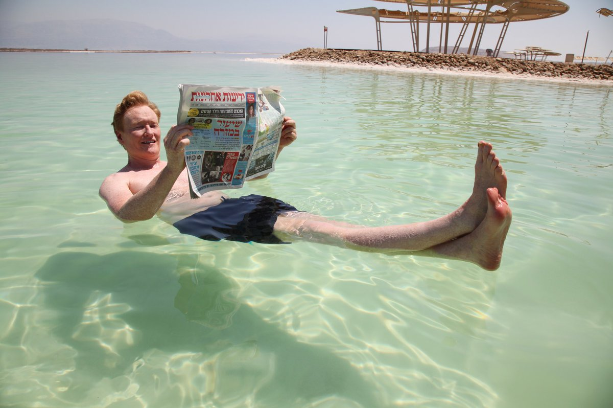 Floating in the #DeadSea and enjoying Garfield in Hebrew. #ConanIsrael #Israel