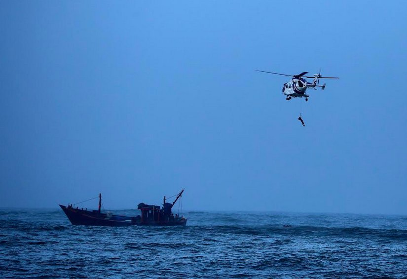 Coast Guard air-lifts 8 crew of a fishing boat stranded in sea off Porbandar coast