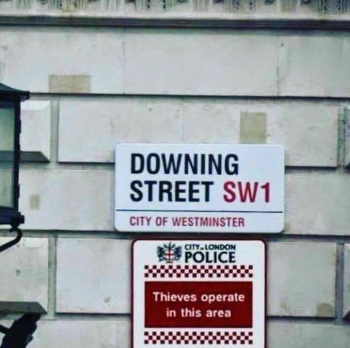 Signs in Downing Street, London, England