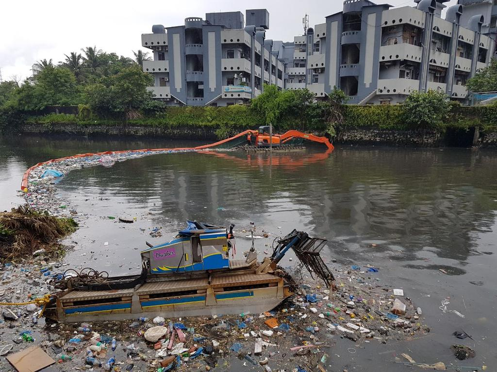 Inflatable Boom Ancd To A Sline Captures Floating Plastic Trash On River Skimmer Boat At The S