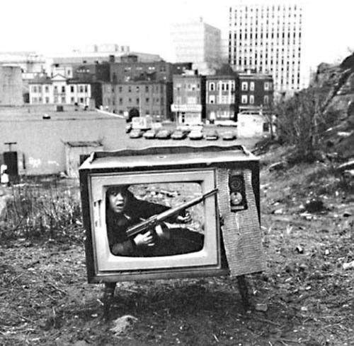 PHOTO OF THE DAY. A boy playing in an abandoned TV set in Boston (1972). https://t.co/dhJiQVeuDY
