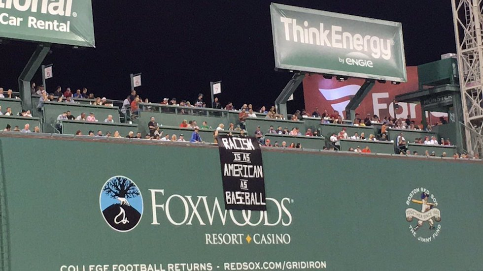 'Racism is as American as baseball' banner displayed at Fenway Park https://t.co/Pbxx83mTub