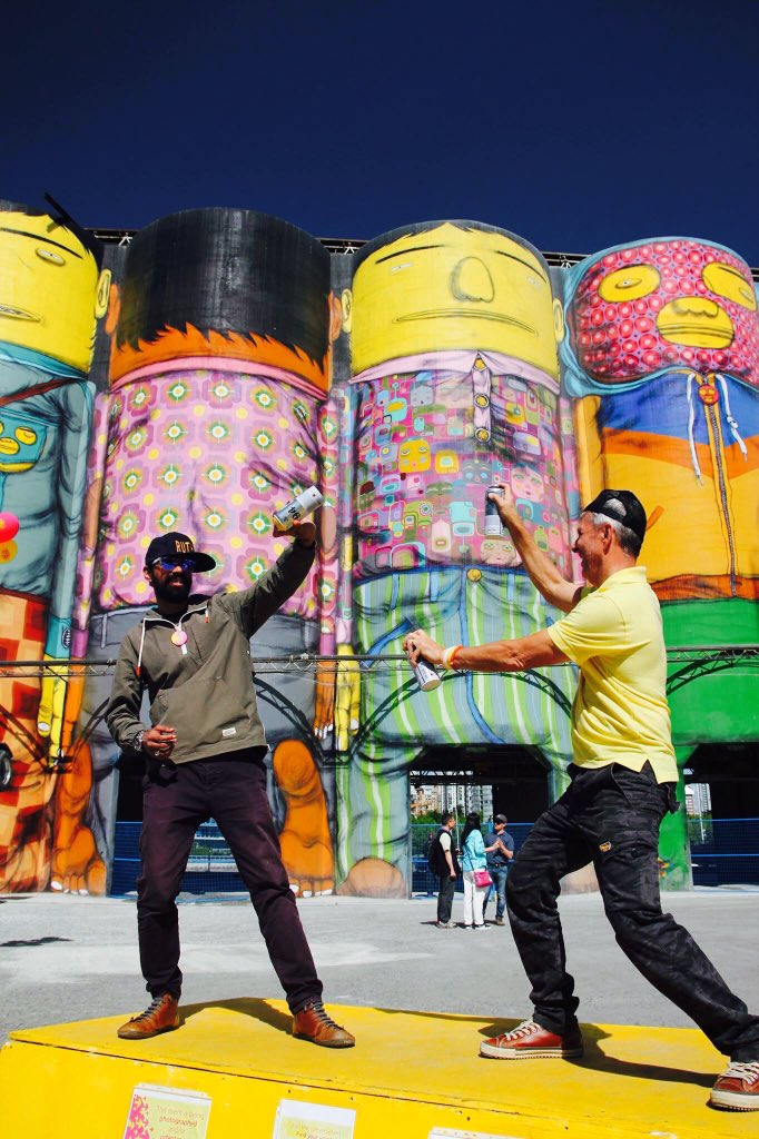 Great pic of @OsGemeos&#39;s #GIANTS #mural on @granville_isle! Summer&#39;s not over yet! This #VanBiennale #publicart engages all visitors. #tbt<br>http://pic.twitter.com/BBL7tgvIJ4