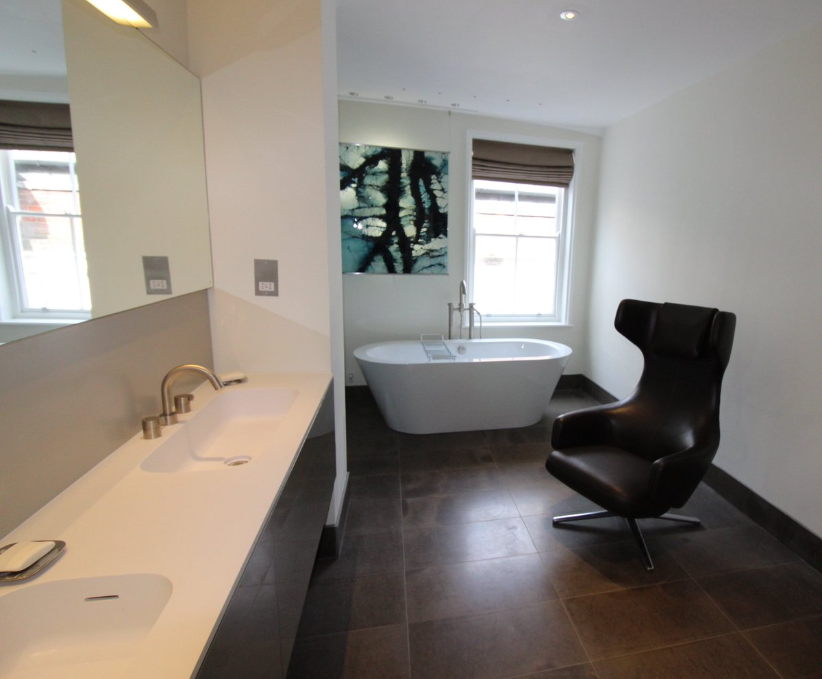 A #bathroomdesign I did a while ago for 2 art dealers. Sleek #stoneflooring &amp; brushed nickel taps gave the design a fab #contemporary feel<br>http://pic.twitter.com/2km7d717KF