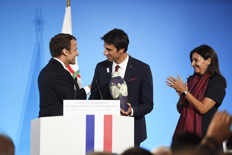 test Twitter Media - .@Paris2024 Makes Triumphant Return To France With A Presidential Welcome https://t.co/zLd6aDyeqp https://t.co/73Wls9WihQ