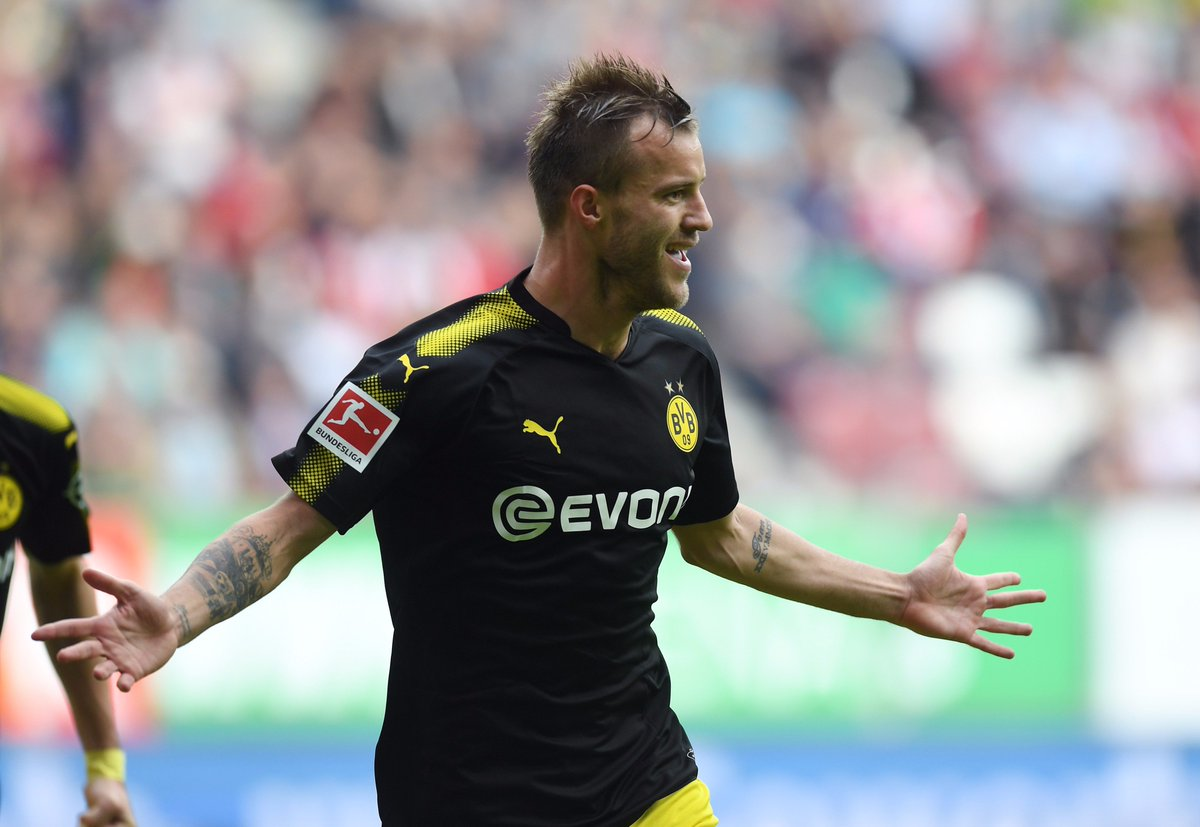 Dortmund win 2-1 at augsburg to go five points clear at the