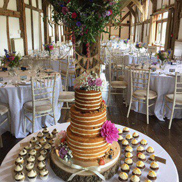 Tempting #naked #wedding #cake from @thecrumbybakery & #flowers by  @Angellike1 for Saturday's #wedding in the #barn