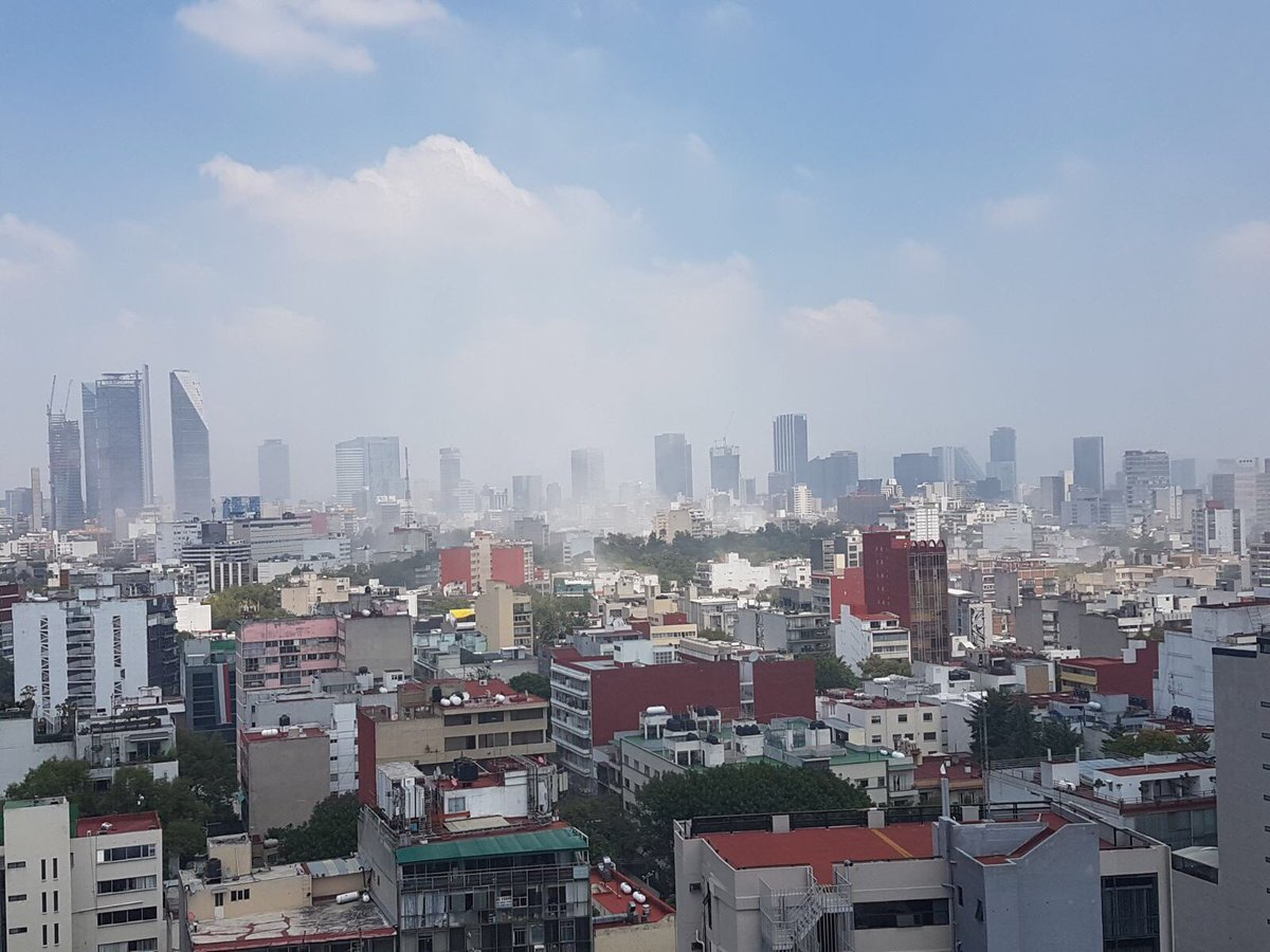 Smoke in Mexico City following the earthquake. We have evacuated the building from the 14th floor. Still shaking. https://t.co/8H3ZkDo6RE