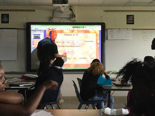 Mr. Wilde helping our students discover the difference between positive and negative exponents.  #RiseToTheChallenge <br>http://pic.twitter.com/z1R0s5zmTA