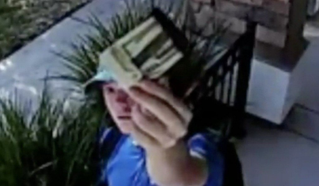 Teen shown on camera returning wallet (and $1,500) to owner