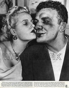 Jake LaMotta after losing a fight.  He went 83-19 and still lived to b...