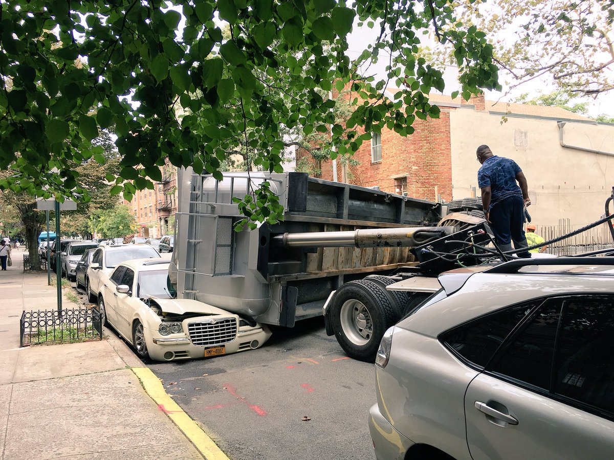 'Twisted' truck crushes parked car in Harlem https://t.co/OMtHtz2eBX