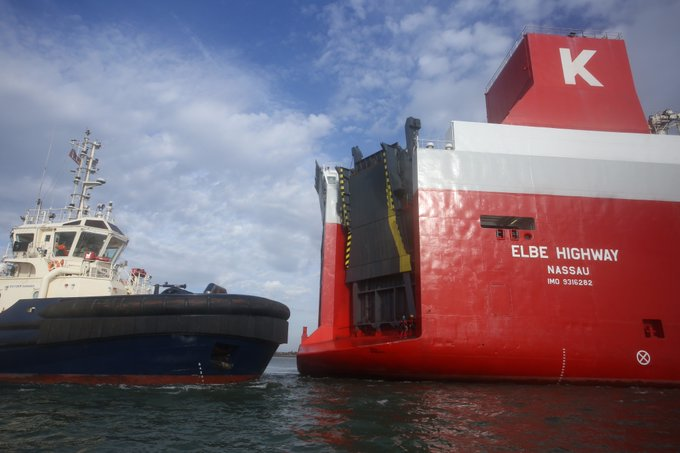 Greenpeace activists draw up alongside the huge car carrier in the Thames Estuary.