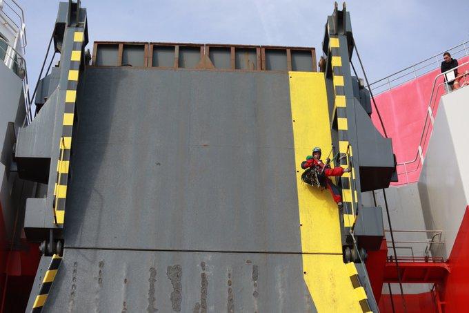 A Greenpeace activist on board the 23,498-tonne ship.