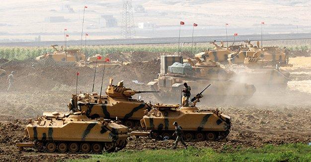 دبابات تركية تجري تدريبا على حدود العراق قبل أسبوع من استفتاء الأكراد DKQIGUSWsAMDZUG