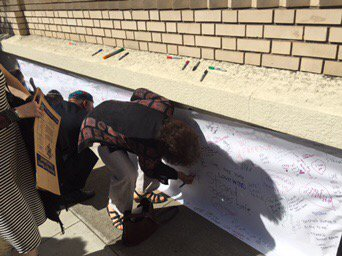Community showing up in strength to cover hateful vandalism on my temple in Oakland with messages of love. Beautiful, poignant.