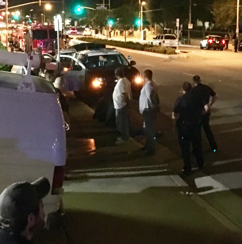 #BREAKING #Newhall: As suspect is put into #LAPD car he appears to yell something to fellow suspects in handcuffs.