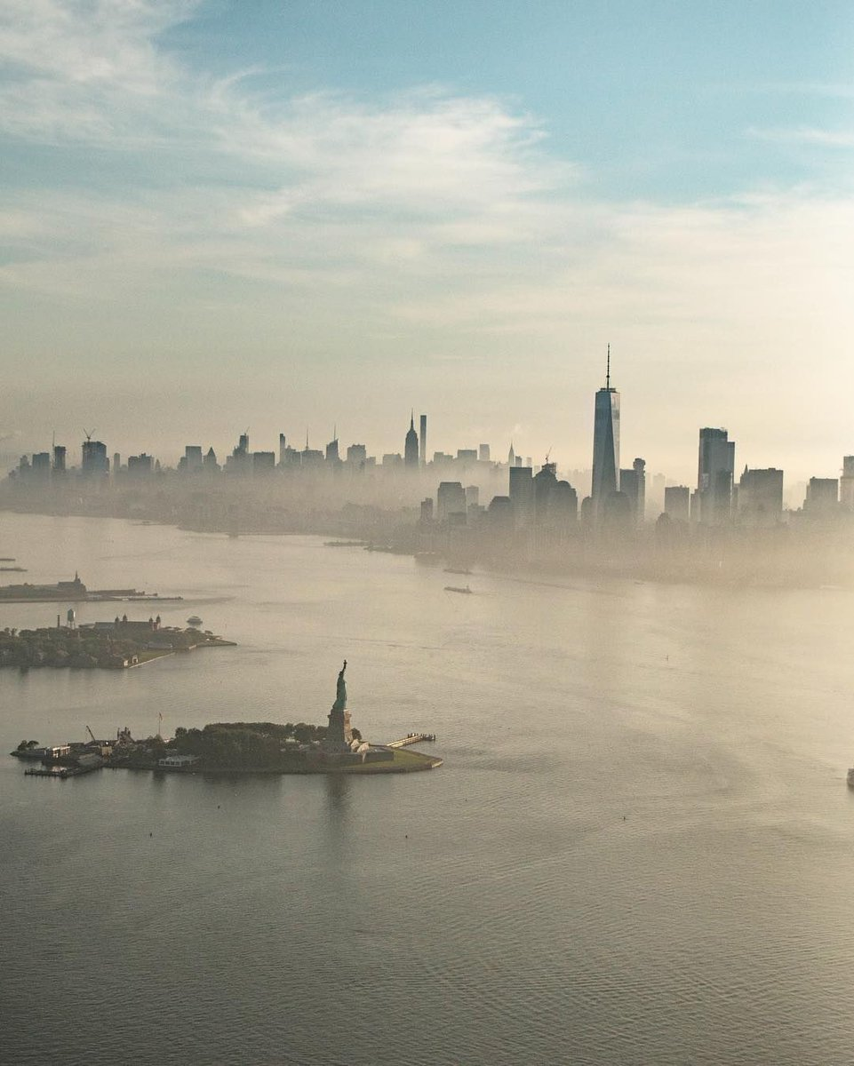 A foggy morning scene over New York Harbor. #SeeYourCity 📸: @_kevincortes via IG
