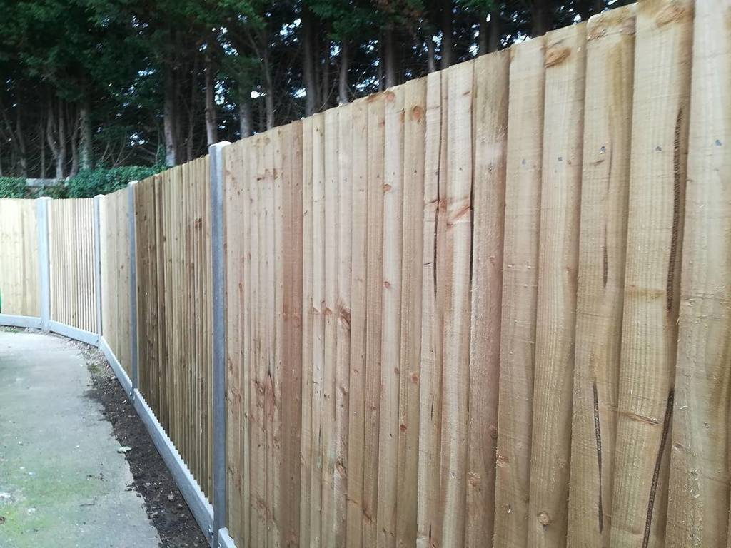 25 bays of 1.8m closeboard fencing with concrete posts and concrete gravel boards.