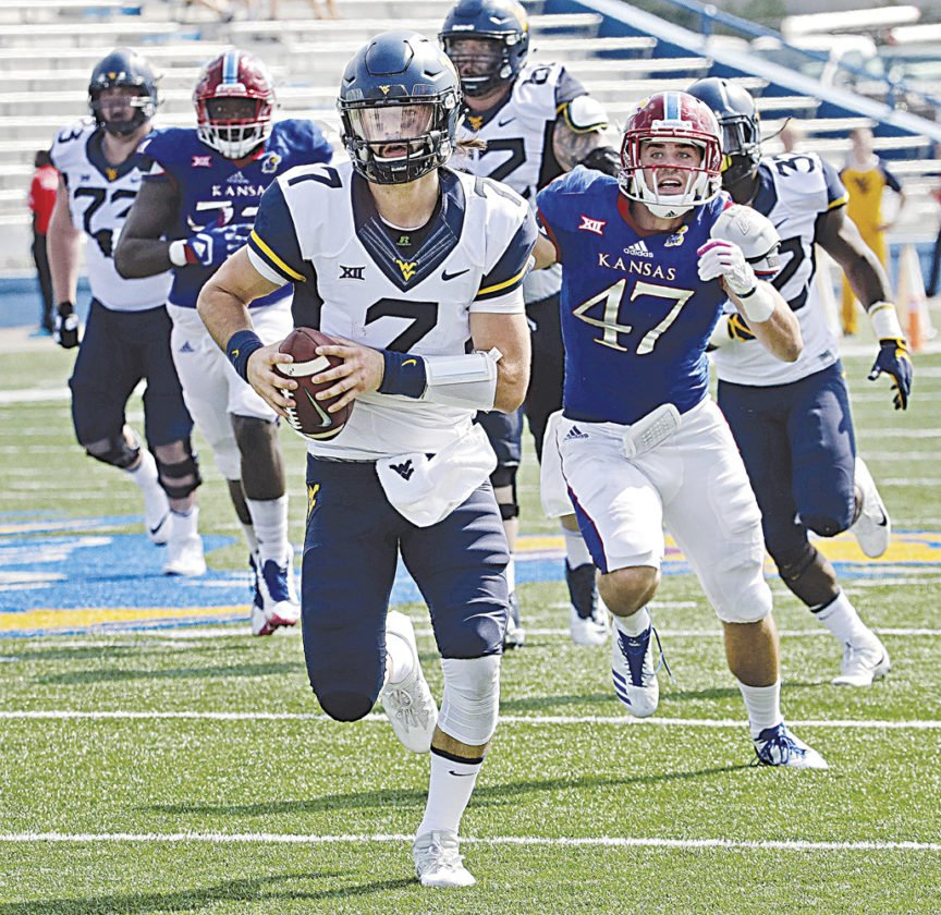 Will Grier is the first #WVU QB in almost 50 years to throw for 300 yards, throw 2 TD&#39;s, and run for 2 TD&#39;s.  http://www. dominionpost.com/Mobile/722039. aspx &nbsp; …  #HailWV<br>http://pic.twitter.com/lNE1owsPJw