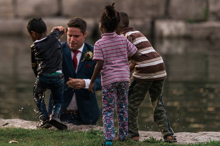 Groom stops wedding photo shoot to jump in river and save child https:...