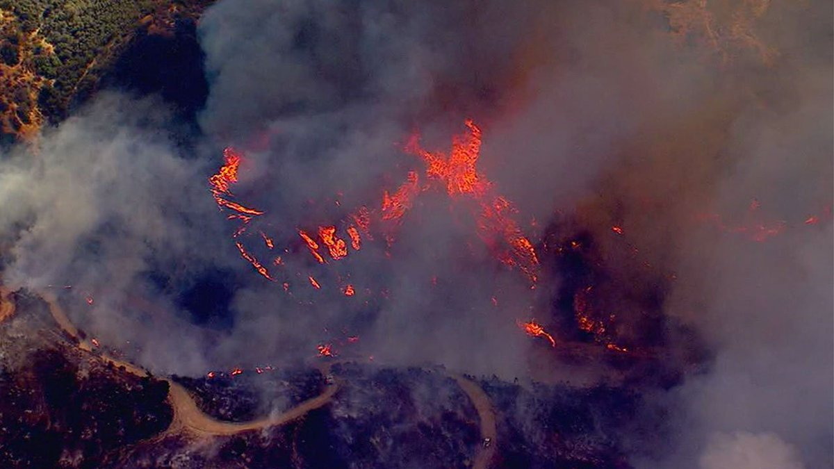 PHOTOS: 150-acre #CanyonFire burning along 91 Freeway in Anaheim area...