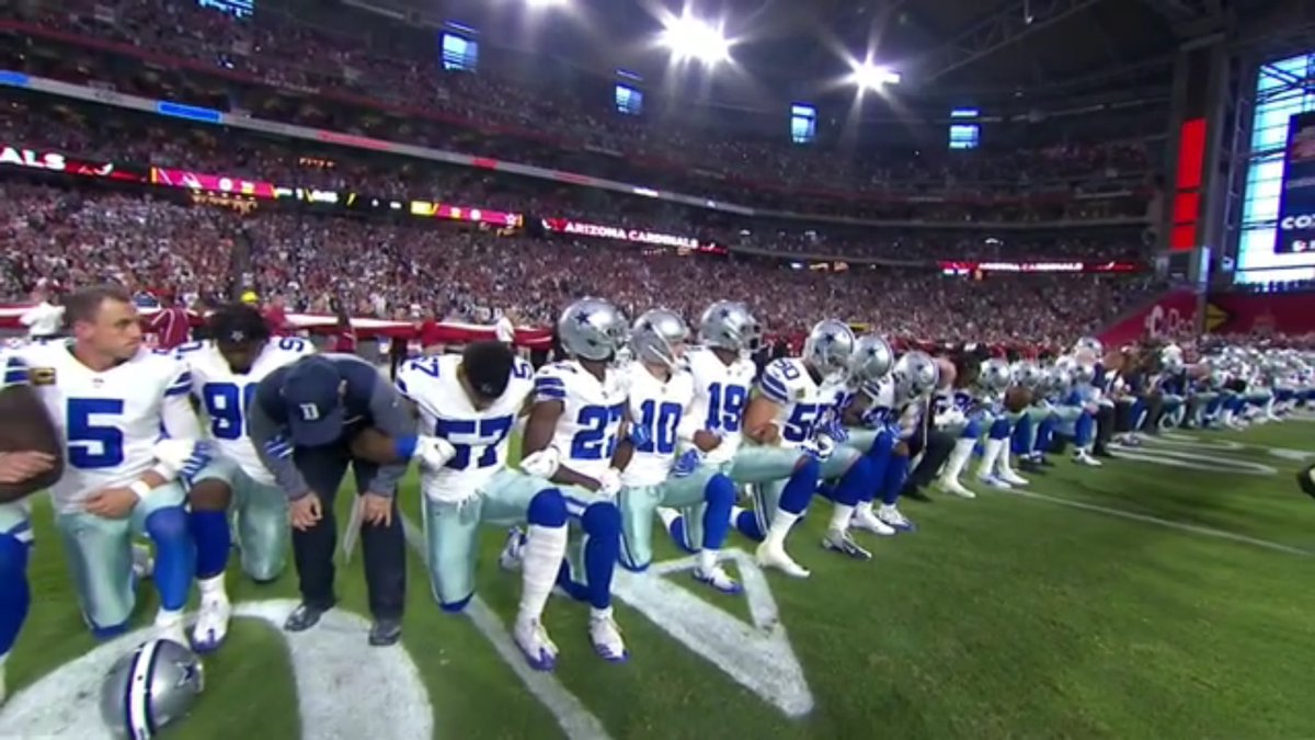 The entire Cowboys team kneeled together -- *before* the anthem -- to...
