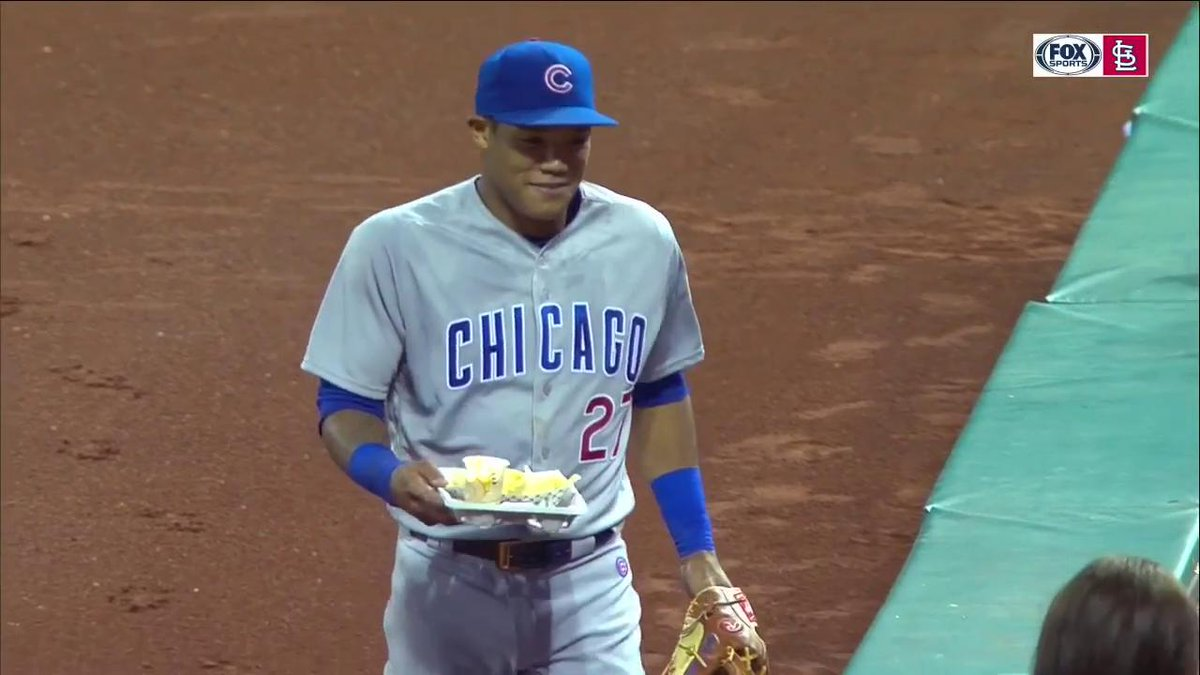 Addison Russell falls into fan's nachos during foul ball pursuit