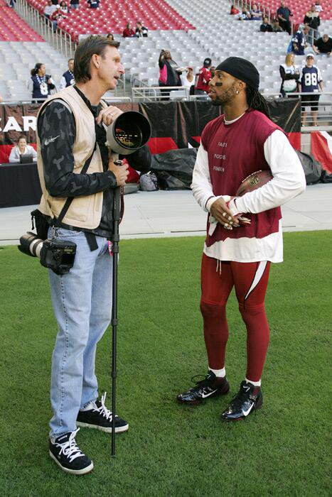 Found this photo from a 2011 Cowboys-Cards game. Nice of Larry Fitzger...