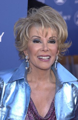 Joan rocking a fabulous metallic jacket at The Grammys in 2001 https://t.co/TSuGccj0OX