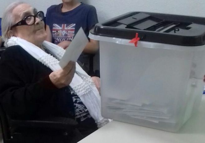 Anti-fascist woman votes in Catalonia