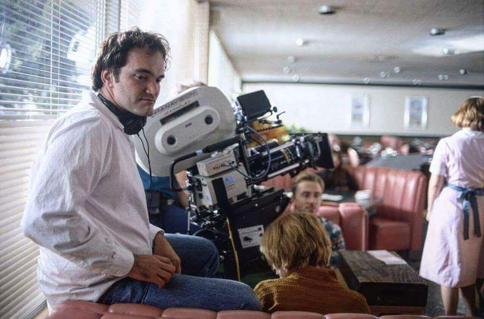 """Quentin Tarantino on the set of """"Pulp Fiction"""" (1994)"""