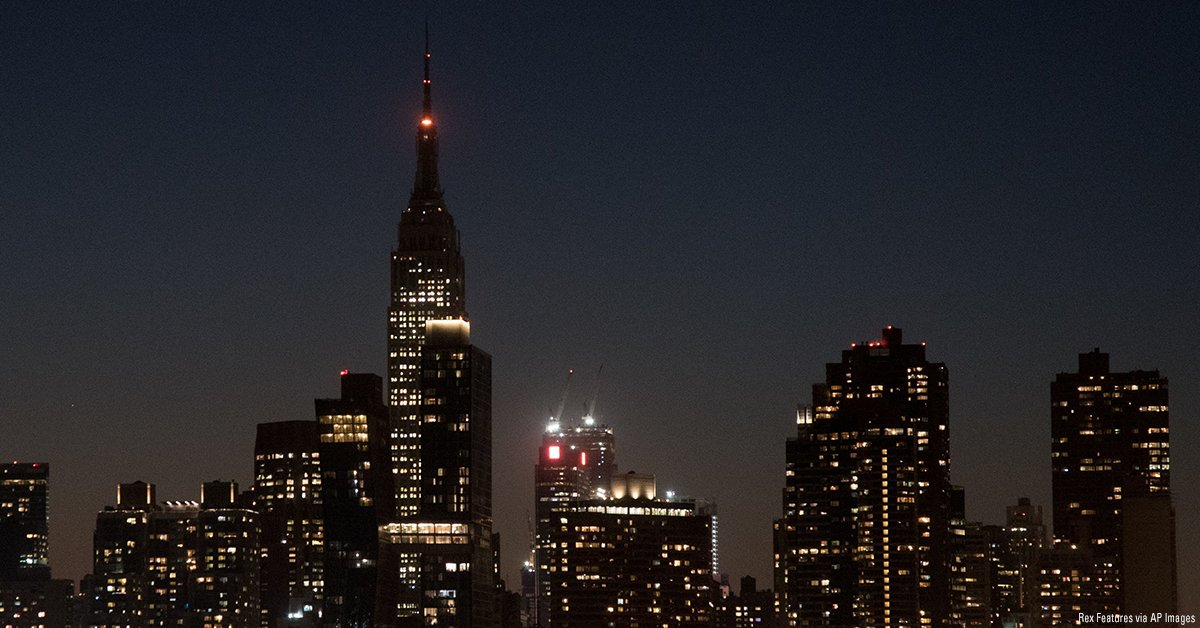 befb49f8f26e The  EmpireStateBldg is lit in darkness with a rotating orange halo in  sympathy for Las