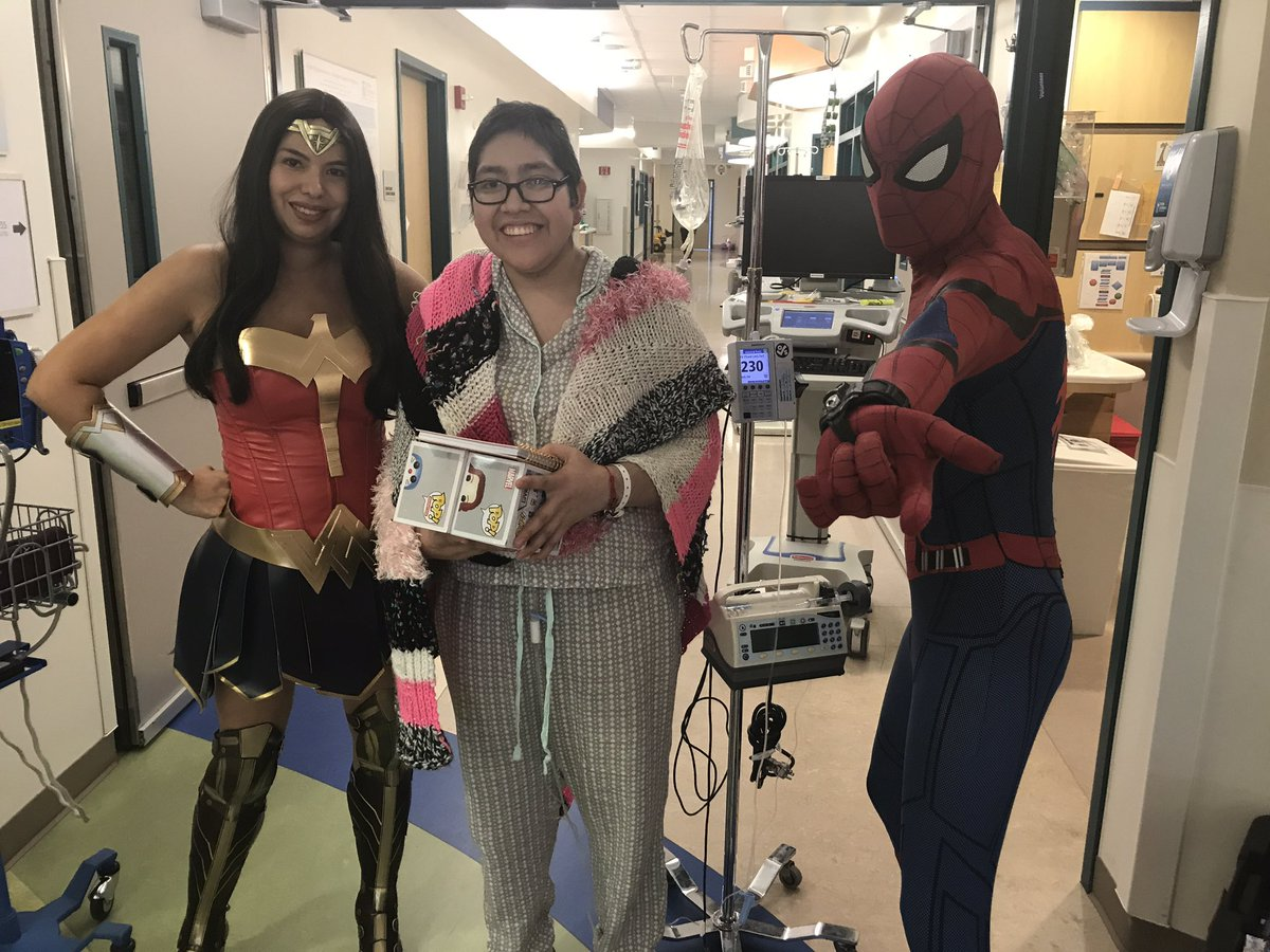 We have some special visitors today! #Wonderwoman and #Spiderman are handing out gifts to our patients.