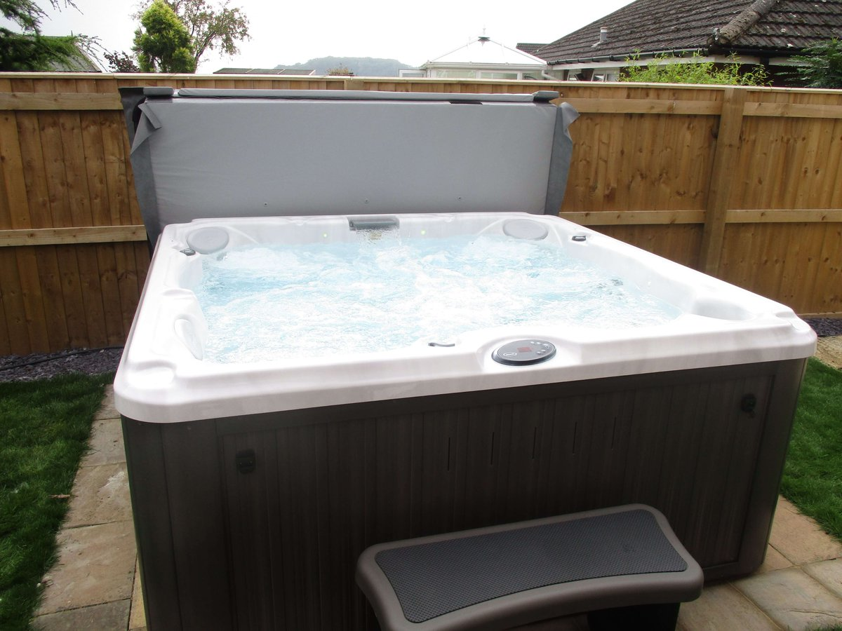 full of hot tubs jacuzzi and tub used outdoor amazing rocks sale plants with for around size it