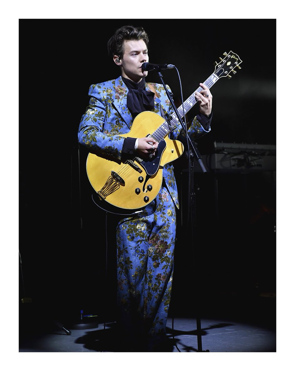 Onstage at The Greek Theatre in Los Angeles, wore a #Gucci custom floral printed suit and silk shirt.