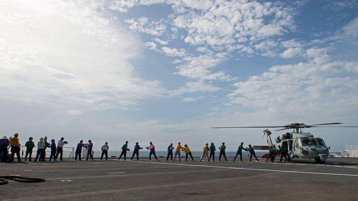 Water Line. @USNavy #sailors load water onto an #MH60 Seahawk near #SanJuan, #PuertoRico.