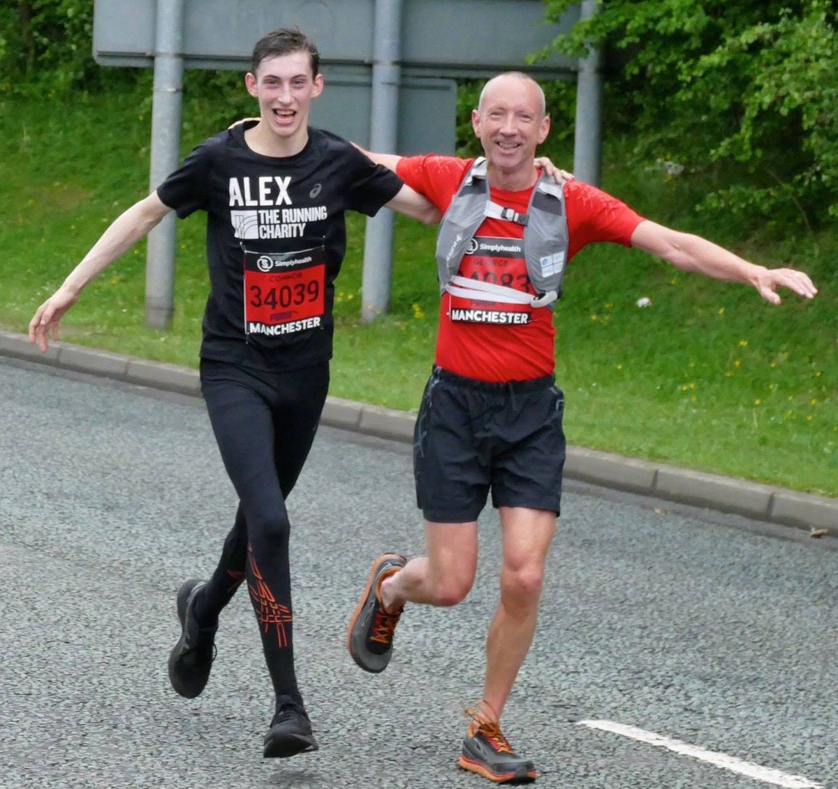 Alex and George reaching the finishing line