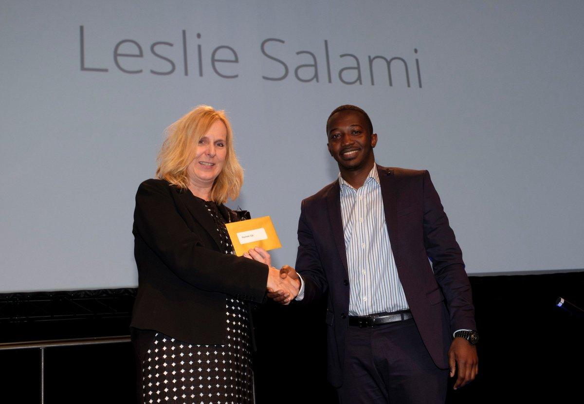 Leslie receiving his award